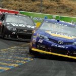 Martin Truex Jr. leads Kurt Busch at Sonoma.