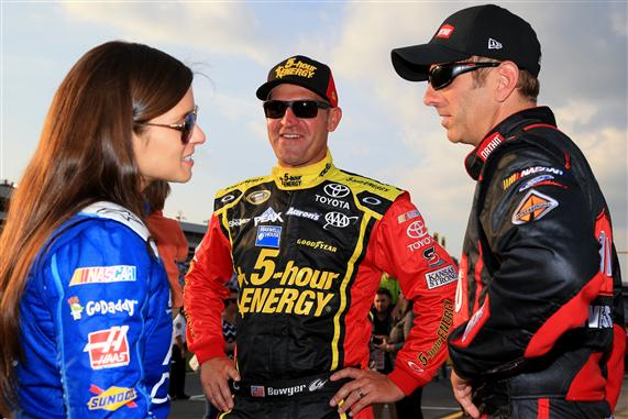 L to R: Danica Patrick, Clint Bowyer and Greg Biffle at Charlotte Motor Speedway on May 15, 2015 (photo courtesy of Getty Images for NASCAR).