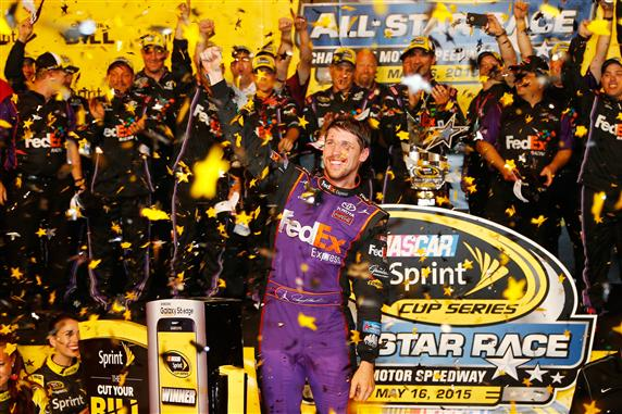 Denny Hamlin celebrates in victory lane after winning the Sprint All-Star Race at Charlotte Motor Speedway on May 16, 2015 (photo courtesy of Getty Images for NASCAR).