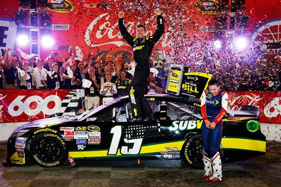 Carl Edwards celebrates in victory lane at Charlotte Motor Speedway after winning the Coca-Cola 600 on May 24, 2015 (photo courtesy of Getty Images for NASCAR).