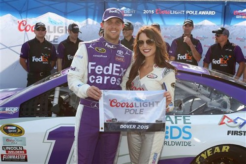 Denny Hamlin celebrates  his pole-winning run at Dover International Speedway on May 29, 2015 (photo courtesy of Getty Images for NASCAR).
