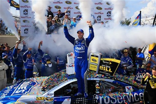 Jimmie Johnson celebrates in victory lane after winning the FedEx 400 Benefiting Autism Speaks at Dover International Speedway on May 31, 2015 (photo courtesy of Getty Images for NASCAR).
