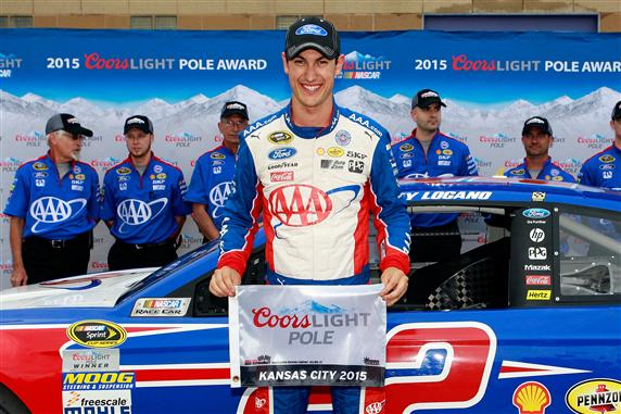 Joey Logano wins the pole for the SpongeBob SquarePants 400 NASCAR Sprint Cup Series race at Kansas Speedway on May 8, 2015 (photo courtesy of Getty Images for NASCAR)