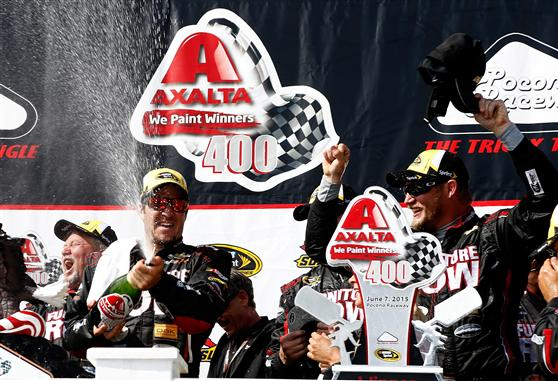 Martin Truex Jr. and Furniture Row Racing celebrate in victory lane at Pocono Raceway on June 7, 2015 (photo courtesy of Getty Images for NASCAR).