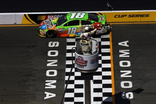 Kyle  Busch takes the checkered flag to win the Toyota/SaveMart 350 at Sonoma Raceway (photo courtesy of Getty Images for NASCAR).
