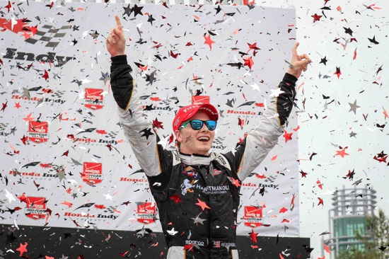 Josef Newgarden, driver of the #67 Hartman Oil CFH Racing Chevrolet V-6 IndyCar, celebrates his victory Sunday, June 14, 2015 after winning the Verizon IndyCar Series race through the streets of Toronto, Ontario, Canada. Newgarden's teammate, Luca Filippi, driver of the #20 Fuzzy's Vodka CFH Racing Chevrolet V-6, finished second. (Photo by Phillip Abbott/LAT for Chevy Racing)