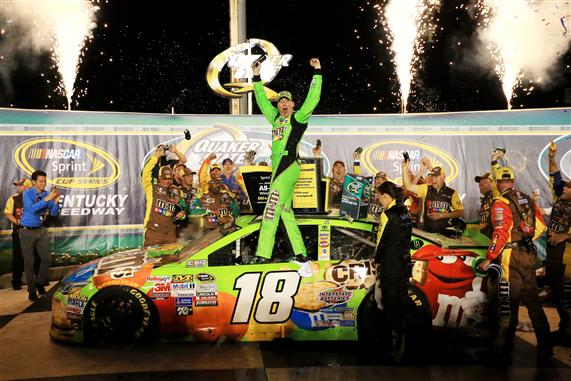 Kyle Busch celebrates in victory lane after winning the Quaker State 400 at Kentucky Speedway on July 11, 2015 (photo courtesy of Getty Images for NASCAR)