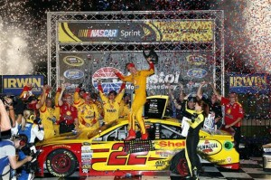 Joey Logano celebrates in victory lane at Bristol Motor Speedway after winning the Irwin Tools Night Race on Aug. 22, 2015 (photo courtesy of Getty Images for NASCAR).