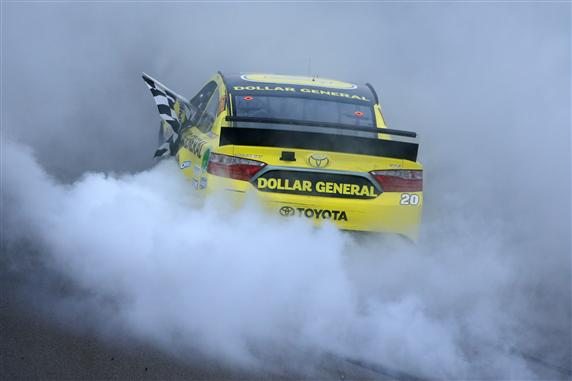 Matt Kenseth celebrates his win of the Pure Michigan 400 at Michigan International Speedway (photo courtesy of Getty Images for NASCAR)
