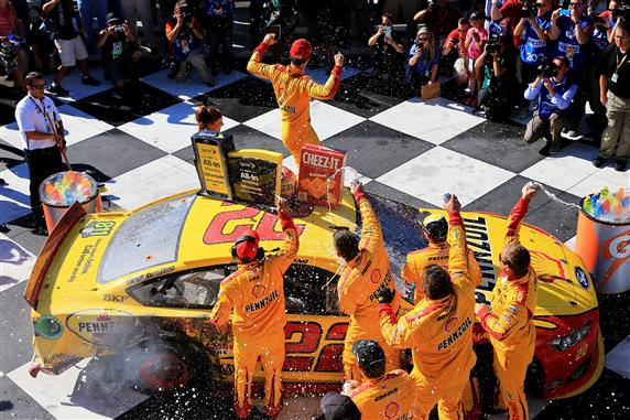 Joey Logano celebrates in victory lane at Watkins Glen International after winning the Cheez-It 355 on Aug. 9, 2015 (photo courtesy of Getty Images for NASCAR).