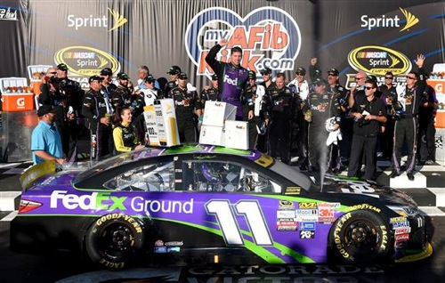 Denny Hamlin celebrates in victory lane at Chicagoland Speedway (photo courtesy of Getty Images for NASCAR).