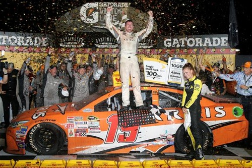 Carl Edwards celebrates in victory lane at Darlington Raceway after winning the Bojangles' Southern 500 on Sept. 6, 2015 (photo courtesy of Getty Images for NASCAR).