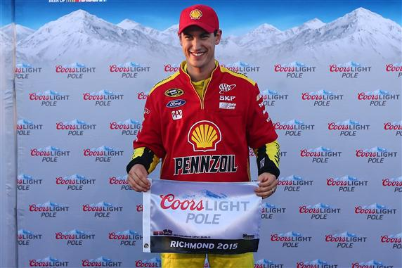 Joey Logano celebrates his pole start for the Federated Auto Parts 400 at Richmond International Raceway (photo courtesy of Getty Images for NASCAR).