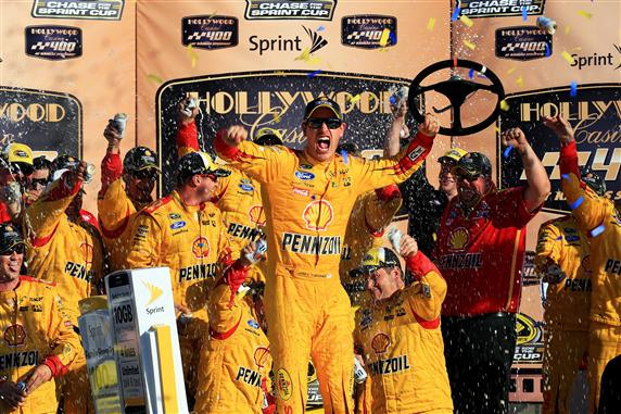 Joey Logano celebrates in victory lane at Kansas Speedway after winning the Hollywood Casino 400 on Oct. 18, 2015 (photo courtesy of Getty Images for NASCAR).