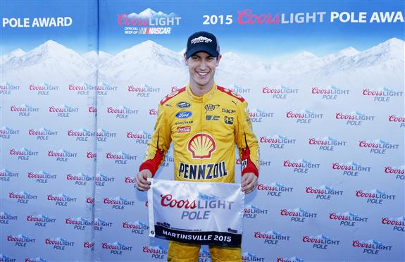 Joey Logano celebrates a Martinsville Speedway pole on Oct. 30, 2015 (photo courtesy of Getty Images for NASCAR).