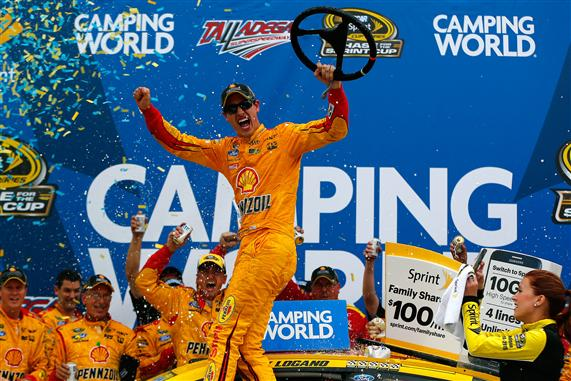 Joey Logano celebrates in victory lane at Talladega Superspeedway after winning the CampingWorld.com 500 (photo courtesy of Getty Images for NASCAR).