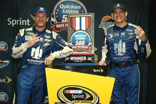 Dale Earnhardt Jr (left) and crew chief Greg Ives celebrate in victory lane at Phoenix International Raceway on Nov. 15, 2015 (photo courtesy of Getty Images for NASCAR).