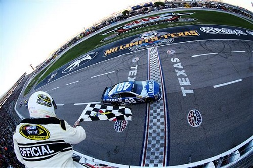 Jimmie Johnson takes the checkered flag in the AAA Texas 500 at Texas Motor Speedway (photo courtesy of Getty Images for NASCAR).
