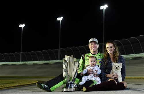 Kyle Busch celebrates his first NASCAR Sprint Cup championship with wife Samantha Busch and son Brexton Busch at Homestead-Miami Speedway on Nov. 22, 2015 (photo courtesy of Getty Images for NASCAR).