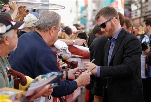 Dale Earnhardt Jr. signs autographs Wednesday in Las Vegas during NASCAR Champion's Week (photo courtesy of Getty Images for NASCAR).
