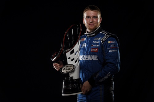 Chris Buescher poses for a portrait with his 2015 NASCAR Xfinity Series champion's trophy (photo courtesy of Getty Images for NASCAR).