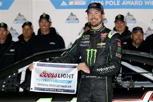Kurt Busch celebrates his pole win at Atlanta Motor Speedway on Friday (photo courtesy of Getty Images for NASCAR).