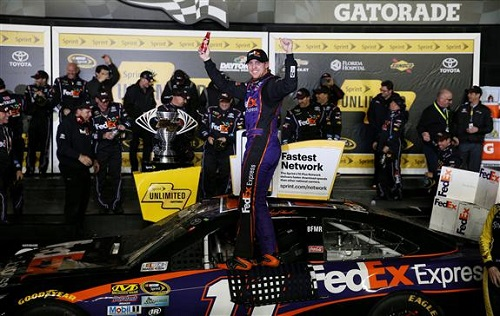 Denny Hamlin celebrates his Sprint Unlimited win at Daytona International Speedway on Feb. 13, 2016 (photo courtesy of Getty Images for NASCAR).