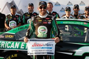 Austin Dillon celebrates winning the pole at Auto Club Speedway on March 18, 2016 (photo courtesy of Getty Images for NASCAR).