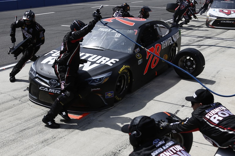 The No. 78 Furniture Row Racing team of Martin Truex Jr. performs a routine pit stop at Auto Club Speedway in Fontana, Calif., in March 2016 (photo courtesy of Getty Images for NASCAR).