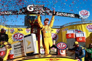 Kyle Busch celebrates in victory lane at Martinsville Speedway after winning the STP 500 on April 3, 2016 (photo courtesy of Getty Images for NASCAR)