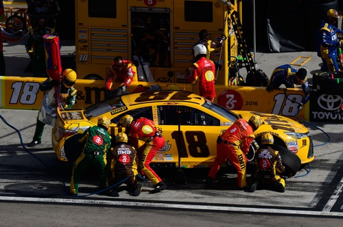 The No. 18 Joe Gibbs Racing Toyota team in the NASCAR Sprint Cup Series performs a routine pit stop at Las Vegas Motor Speedway in March 2016 (photo courtesy of Getty Images for NASCAR).