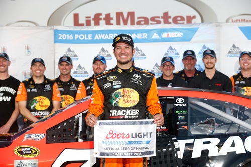 Martin Truex Jr. in victory lane at Charlotte Motor Speedway on May 26, 2016, after winning the pole for the Coca-Cola 600 (photo courtesy of Getty Images for NASCAR).