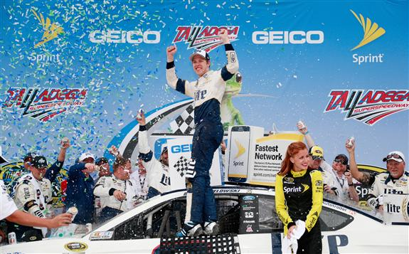 Brad Keselowski celebrates in victory lane at Talladega Superspeedway after winning the Geico 500 on May 1, 2016 (photo courtesy of Getty Images for NASCAR).