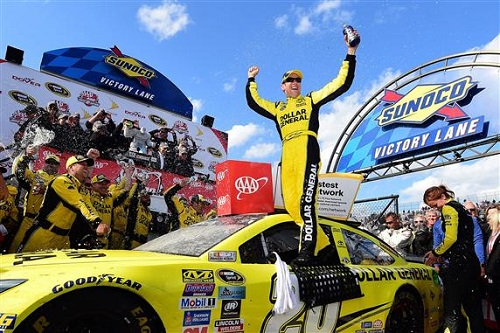 Matt Kenseth celebrates in victory lane at Dover International Speedway after winning the AAA 400 Drive for Autism on May 15, 2016 (photo courtesy of Getty Images for NASCAR).
