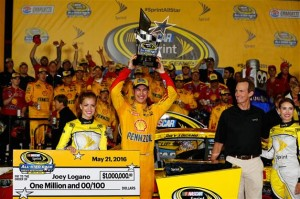Joey Logano celebrates in victory lane at Charlotte Motor Speedway after winning the Sprint All-Star Race on May 21, 2016 (photo courtesy of Getty Images for NASCAR).