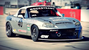 Stephen Cox on his way to a podium finish in Ricksteady Racing's Mazda Miata at Texas World Speedway in May 2015 (photo courtesy of Sopwith Motorsports Television Productions).