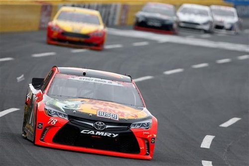 Martin Truex Jr. leads the way in the Coca-Cola 600 at Charlotte Motor Speedway on May 29, 2016 (photo courtesy of Getty Images for NASCAR).