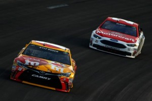 Kyle Busch leads Ryan Blaney in the GoBowling.com 400 at Kansas Speedway on May 7, 2016 (photo courtesy of Getty Images for NASCAR)