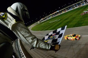Kyle Busch took the checkered flag in the GoBowling.com 400 at Kansas Speedway on May 7, 2016 (photo courtesy of Getty Images for NASCAR).