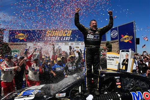 Tony Stewart celebrates in victory lane at Sonoma Raceway after winning the Toyota/Save Mart 350 on June 26, 2016 (photo courtesy of Getty Images for NASCAR).