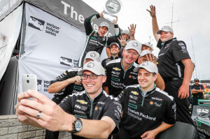 Simon Pagenaud (top left), driver of the #22 Hewlett Packard Enterprise Team Penske Chevrolet IndyCar V6, celebrates with his team after capturing his second pole position of the weekend Sunday, June 5, 2016 for the second of two Verizon IndyCar Series Chevrolet Dual In Detroit races on Belle Isle in Detroit, Michigan. (Photo by Michael L. Levitt/LAT for Chevy Racing)