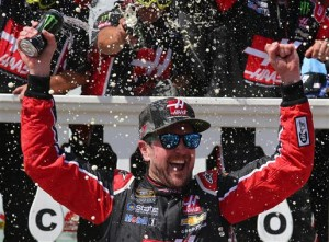 "Kurt Busch celebrates in victory lane at Pocono Raceway after winning the Axalta ""We Paint Winners"" 400 on June 7, 2016 (photo courtesy of Getty Images for NASCAR)."