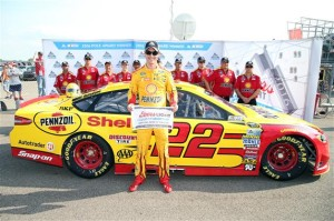 Joey Logano celebrates winning the pole for the FireKeepers Casino 400 at Michigan International Speedway on June 10, 2016 (photo courtesy of Getty Images for NASCAR).