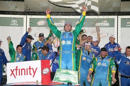 Aric Almirola celebrates in victory lane at Daytona Imternational Speedway after winning the Firecracker 250 on July 1, 2016 (photo courtesy of Getty Images for NASCAR).