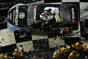 Brad Keselowski celebrates in victory lane at Daytona International Speedway after winning the Coke Zero 400 on July 2, 2016 (photo courtesy of Getty Images for NASCAR).