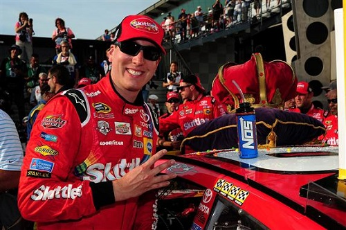 Kyle Busch celebrates winning the Combat Wounded Coalition 400 at Indianapolis Motor Speedway on July 24, 2016 (photo courtesy of Getty Images for NASCAR).