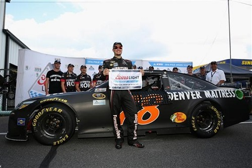 Martin Truex Jr. celebrates capturing the pole for the Pennsylvania 400 at Pocono Raceway on July 29, 2016 (photo courtesy of Getty Images for NASCAR).
