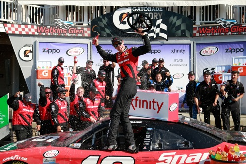 Joey Logano celebrates in victory lane at Watkins Glen International after winning the Zippo 200 on Aug. 6, 2016 (photo courtesy of Getty Images for NASCAR).