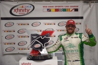 Justin Marks celebrates his win of the Mid-Ohio Challenge at Mid-Ohio Sports Car course on Aug. 13, 2016 (photo courtesy of Getty Images for NASCAR).