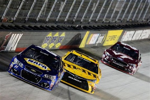 Chase Elliott (24), Kyle Busch (18), and Denny Hamlin (11) in the Bass Pro Shops NRA Night Race at Bristol Motor Speedway on Aug. 20, 2016.